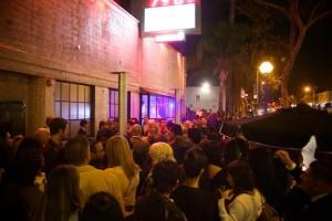People packing the sidewalk outside DBA. (Photo by Matt Baume)