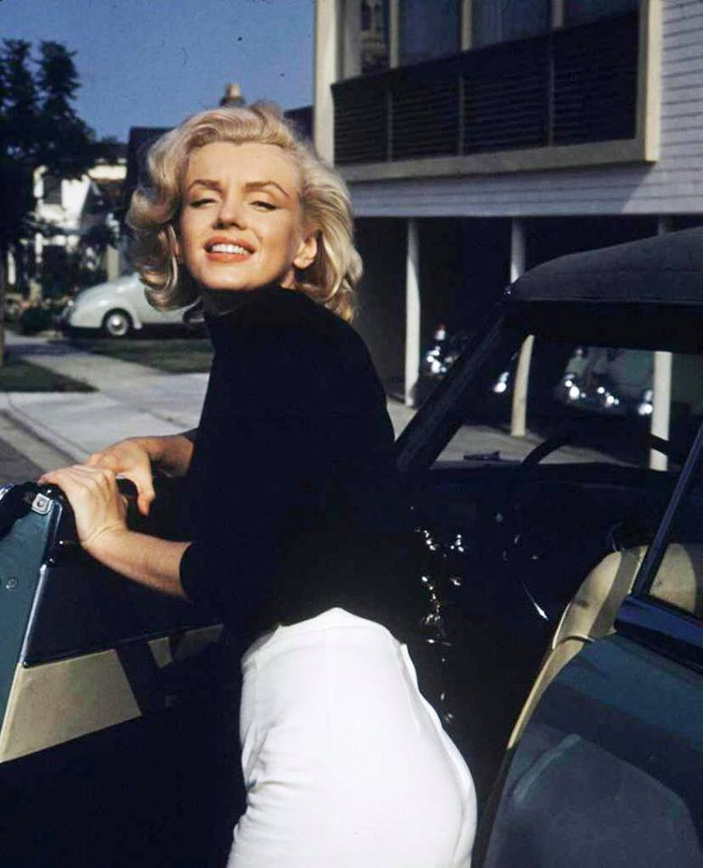 Marilyn Monroe outside her apartment building on Cynthia Street in West Hollywood