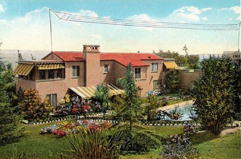 Picture postcard view of the back of silent-film star Wallace Reid's home at De Longpre and Sweetzer avenues in Hacienda Park -- as seen from tourist buses on Sunset