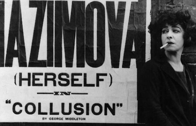 Alla Nazimova photographed with the poster for the controversial play, 'Collusion,' 1923
