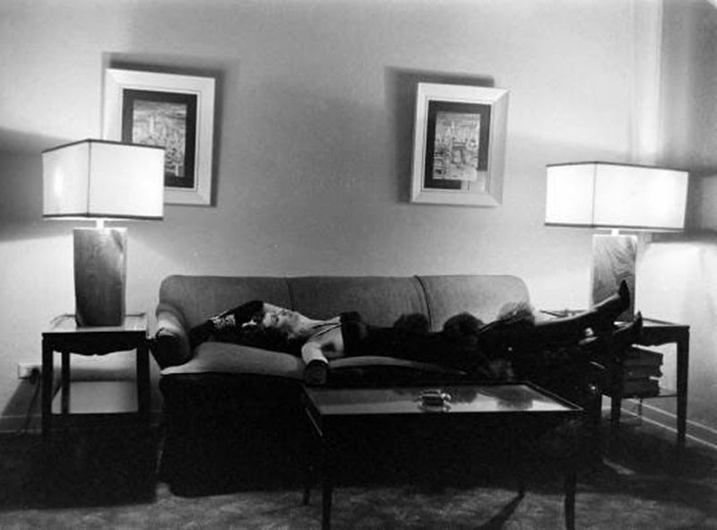 A woman relaxes in a villa at the Garden of Allah during the hotel's farewell party, August 1959