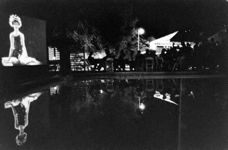 Naziimova's 'Salome' projected on a wall above her swimming pool at the Garden of Allah's closing party, August 1959